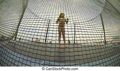Baby girl at trampoline