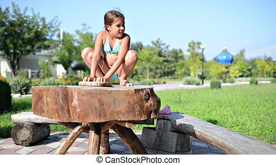 Baby girl at wood table