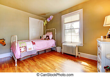 Baby girl bedroom interior with pink bed.