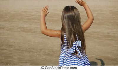 baby girl blue striped dress dancing