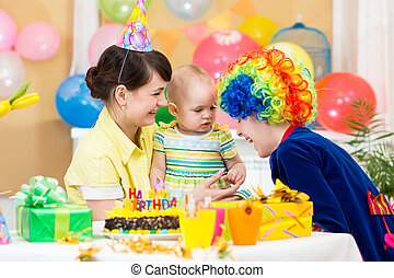 baby girl celebrating first birthday and clown