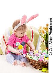 Baby girl choose Easter eggs