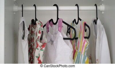 Baby girl clothes in wardrobe - Wardrobe with baby girl...