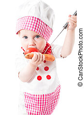 Baby girl cook wearing a chef hat with vegetables and pan isolated on white background.The concept of healthy food and childhood