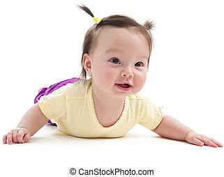 Baby girl doing tummy time - Baby girl smiling posing on her...