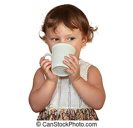 Baby girl drinking from cup isolated on white background