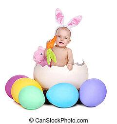 baby girl easter rabbit sitting in a giant easter egg