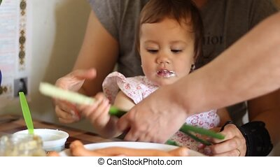 Baby Girl Eating at Table