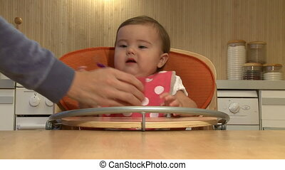 Baby girl eating   - Baby girl eating