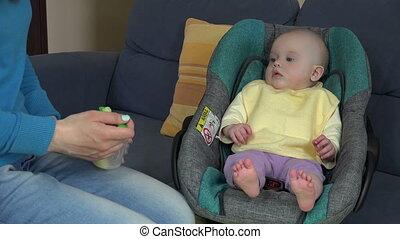 baby girl eating mash