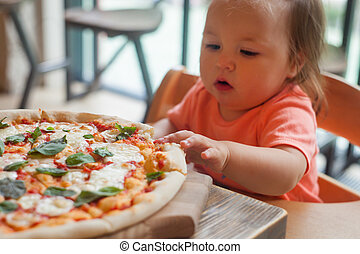 baby girl eating pizza in italian restaurant, Healthy, unhealthy food, children's fast food