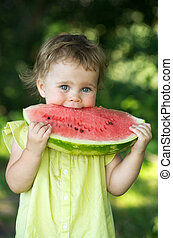 baby girl eating watermelon - cute little baby girl eating...