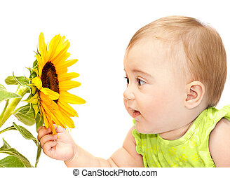 Baby girl exploring flower, elementary study of nature, cute...