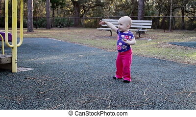 Baby girl getting excited at park