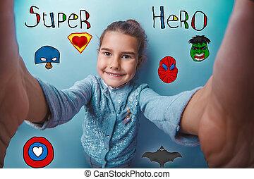 baby girl holding photo camera closeup Selfe super hero super power