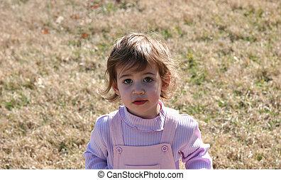 Baby Girl in a Field
