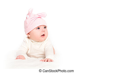 baby girl in a pink hat with rabbit ears isolated on white