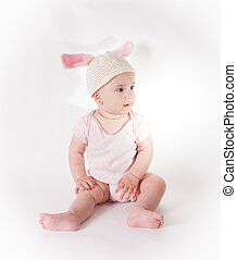 Baby girl in a rabbit hat