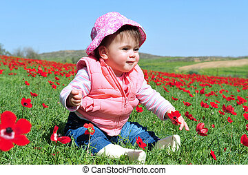 Baby girl in a red poppies field
