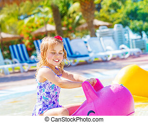 Baby girl in aquapark