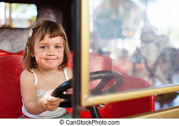 baby girl in carousel