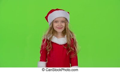 Baby girl in red Christmas caps send air kisses. Green screen