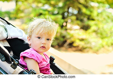 sweet baby girl sitting in stroller