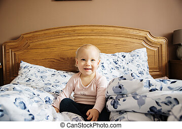 baby girl in the parents bed