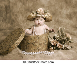 Baby girl in vintage hatbox - Portrait of an adorable baby...