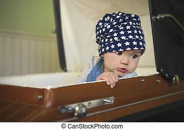 baby girl in vintage stroller