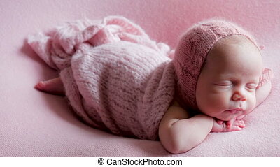 baby girl infant in dress asleep in the crib