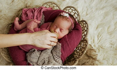 baby girl infant lies to the basket