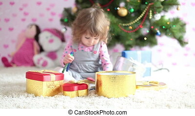 Baby girl is preparing a Christmas