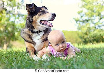 Baby Girl Laying Outside with Pet German Shepherd Dog