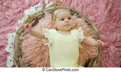 baby girl lies in basket