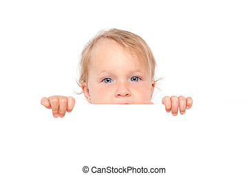 Baby girl looking over white board. - Cute blonde baby girl...