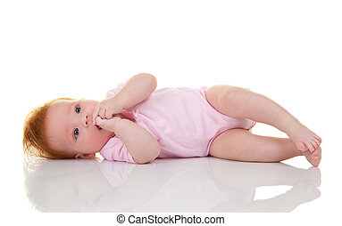 Baby girl lying on white