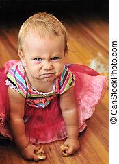 baby girl make face
