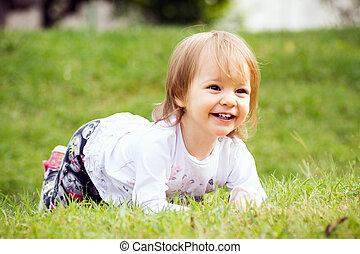 baby girl on grass