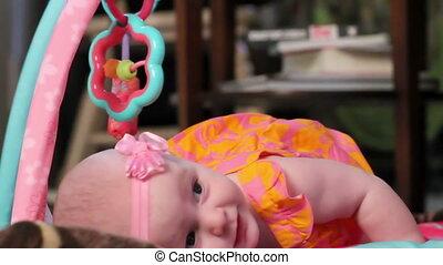 Baby girl on play mat