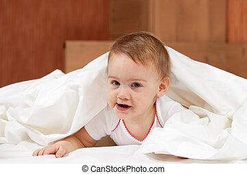 Baby girl on white sheet - Baby girl laying on white sheet