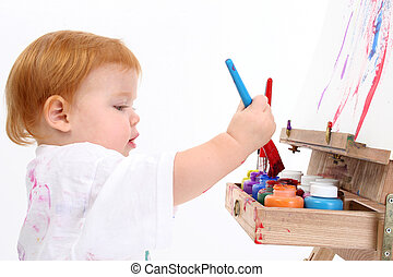 Baby Girl Painting - Adorable Baby Girl Painting At Easel....