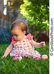 Baby girl play on park grass