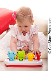 Baby girl play with toy