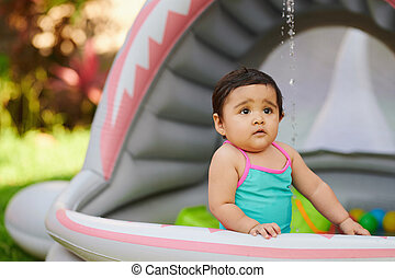 Baby girl play with water spalsh