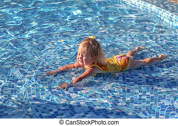 Baby girl playing in pool