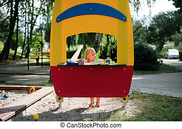 baby girl playing in the children playground
