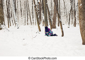 Baby girl playing in the snow