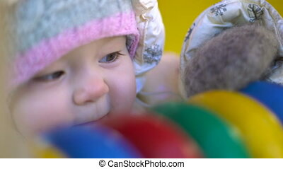 Baby girl playing with abacus closeup portrait - Baby girl...