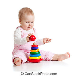 baby girl playing with color developmental toy